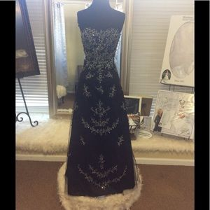 Black Beaded Strapless Formal with corset back .